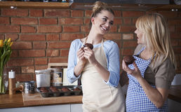 Two women in the kitchen stock images