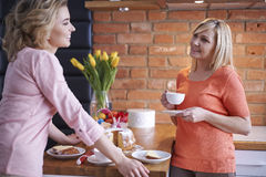 Two women in the kitchen Stock Image