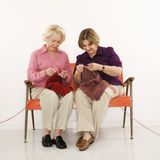 Two women knitting. stock image