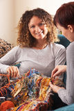 Two Women Knitting Together At Home Stock Photography
