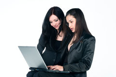 Two women with laptop Royalty Free Stock Photos