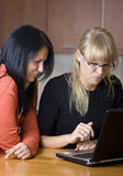 Two women on laptop Royalty Free Stock Image