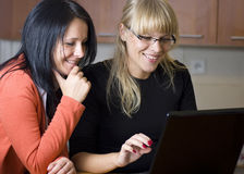 Two women on laptop stock photo