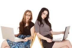 Two women laptops both looking Stock Images