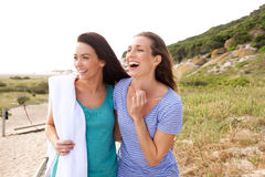 Two women laughing in a park. Portrait of two women laughing in a park Royalty Free Stock Images