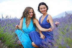 Two women on lavender field Stock Photo