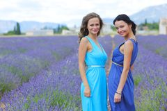 Two women on lavender field Royalty Free Stock Image