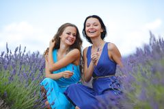 Two women on lavender field Royalty Free Stock Photo