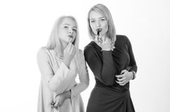 Two women with lipsticks Royalty Free Stock Images