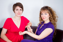Two women in living room Royalty Free Stock Photo