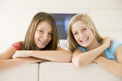 Two women in living room smiling Stock Image