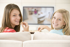 Two women in living room watching television Royalty Free Stock Image