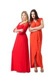 Two women in long red dress Stock Photos