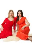 Two women in long red dress Royalty Free Stock Images