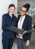 Two women are looking at a file Stock Images