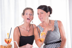 Two women looking at an invisible man Stock Photos
