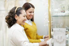 Two women  looks bridal accessories. At store of wedding fashion Stock Image