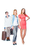 Two women and a luggage porter Stock Images