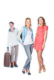 Two women and a luggage porter Royalty Free Stock Images