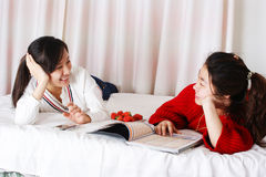 Two women lying on the bed Stock Photography