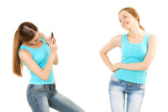 Two women make the photo to mobile phone Stock Image