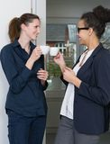 Two women are making a coffee break Royalty Free Stock Image