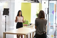 Two women making a corporate demonstration video royalty free stock photography