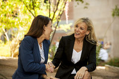 Two women making a deal Royalty Free Stock Photos
