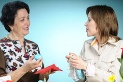 Two women making easter eggs Stock Images