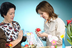 Two women making easter eggs Royalty Free Stock Photo