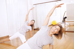 Two women making a fitness exercisen in synchrony Royalty Free Stock Photography