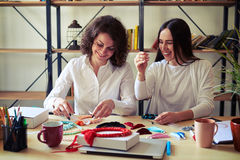 Two women making handmade jewelry Royalty Free Stock Images