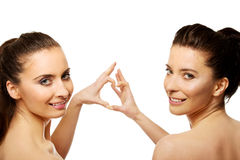 Two women making heart with fingers. Stock Photos