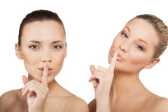 Women making a hush gesture Stock Photos