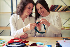 Two women making jewelry together Royalty Free Stock Photos