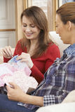 Two Women Making Quilt At Home Together Royalty Free Stock Image