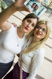 Two women making selfie Stock Photography