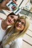 Two women making selfie Stock Photos