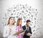 Two women, a man and a business sketch Stock Image