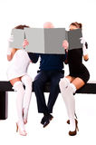 Two women and a man Stock Images