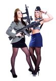 Two women in the marine and the military uniforms with the assau Royalty Free Stock Images