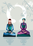 Two Women Meditating Royalty Free Stock Photo