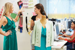 Two Women Meeting In Fashion Design Studio. Talking Royalty Free Stock Images