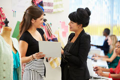 Two Women Meeting In Fashion Design Studio. Smiling Stock Images