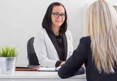 Two women meeting in the office royalty free stock photos