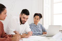 Two women and a man in a meeting stock images