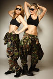 Two women in military clothes army girls Stock Image