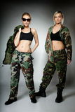 Two women in military clothes, army girls Stock Images