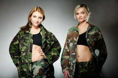 Two women in military clothes, army girls Stock Image