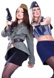 Two women in the military uniform with a guns Royalty Free Stock Images